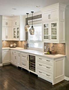 grey cabinets, gray cabinetry, painted kitchen cabinets, beverage area, inset door with beaded face frame openings, panelized ends, quartz counter tops, large cove molding, Dove White. #KitchenCabinet #kitchen #cabinet #ideas