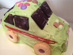 I did lots of research on how to make a car birthday cake for my son's birthday but most of them involved complicated cutting, building and shaping of cakes and then trying to overlay fondant icing.  In my heart of hearts I knew that attempting something like that would end in me being up to the early hours the night before his party with a disaster on my hand.