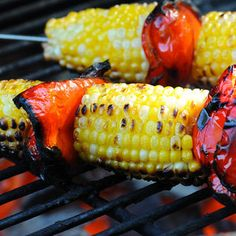 Summertime is the perfect time to roast corn on the grill. Adding red peppers to the skewer adds extra color and flavor appeal.