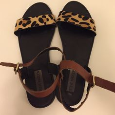 Steve Madden sandals Cheetah print and brown leather flat sandals. Lightly worn, size 9 Steve Madden Shoes Sandals