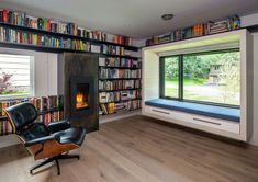Split-level midcentury home gets updated into spectacular sanctuary #library #window #seat #view Wood Staircase, Home Libraries, Level Homes, Sustainable Design, Living Spaces, Mid Century, House Design, Interior, Interieur