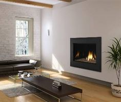 A modern twist on tradition. Heat & Glo's 8000 Modern Gas Fireplace features artistic flames and a reflective interior. Indoor Gas Fireplace, Linear Fireplace, Wood Fireplace, Gas Fireplaces, Fireside Hearth And Home, Wall Mounted Fireplace, Four Seasons Room, Minimalist Decor, Great Rooms