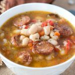 Warm and Hearty White Bean Soup with Sausage - perfect for a cozy cold winter day. This soup has an amazing flavor and is so delicious! Chili Recipes, Soup Recipes, Dinner Recipes, Cooking Recipes, Healthy Recipes, Healthy Foods, Dessert Recipes, Beans And Sausage, Salads
