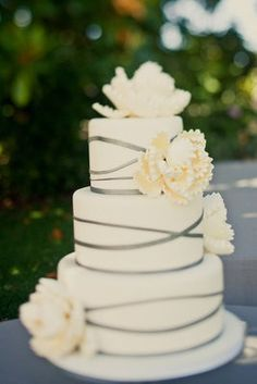 Simple but contemporary with ribbon and flowers.