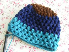 Turquoise, blue & brown crochet hat in puff stitch