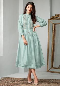 Make the heads flip whenever you dress up in this stunning Baby Blue Color Cotton Slub Readymade Long Kurtis Patterns. the thread work seems to be chic and Designer Kurtis, Designer Wear, Designer Dresses, Silk Kurti Designs, Kurta Designs Women, Indian Kurtis Designs, Cotton Frocks, Cotton Dresses, Pakistani Dresses