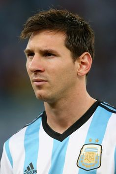 Lionel Messi of Argentina looks on before the 2014 FIFA World Cup Brazil Group F match between Argentina and Bosnia-Herzegovina at Maracana ...