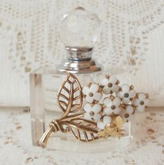 White Flower with Bee Vintage Jewelry Embellished Perfume Bottle by glassbeadtreasures, via Flickr