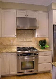 slide in range, stove hood and placement of decorative accent on the backsplash behind the stove
