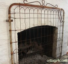 Garden gate as fireplace screen... I love this! Makes me want an outdoor fireplace though!