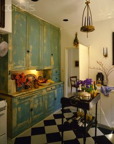 weathered wood cabinets with black & white checkered tile floor ~