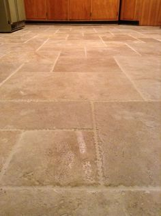 Kitchen Floors - From indoor/outdoor pea green carpeting to PERFECT stone tile!!