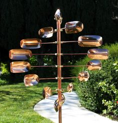 For sale is ONE Kinetic Wind Sculpture Lucky 8 Twirler. The entire wind sculpture including the pole and its fixture is made of pure copper with brass hardware. The only metal is the stainless steel ball bearings that are completely covered by brass hardw Kinetic Wind Spinners, Garden Wind Spinners, Wind Sculptures, Outdoor Sculpture, Garden Sculpture, Sculpture Ideas, Garden Statues, Kinetic Art, Le Moulin