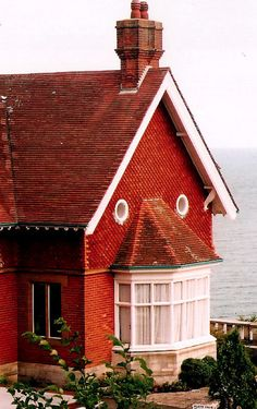 I want a house with a face!! And a view of the ocean would be nice too!!