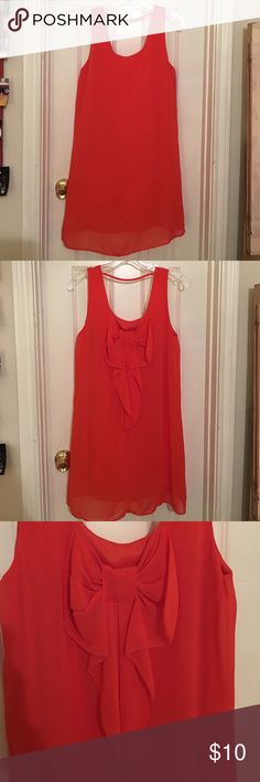 Orange Bow Dress Simple in the front with cute bow in the back. 100 % Polyester. Great condition, lightly worn. jella couture Dresses