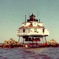 Thomas Point Shoal Light Maryland, USA Chesapeake Bay The current Thomas Point light is arguably the most widely recognized lighthouse in Maryland and is the only screw-pile light on the Chesapeake Bay still in its original location. Chesapeake Bay Bridge, Point Light, Oceans Of The World, Water Tower, Lighthouses, Historical Photos, The Originals, Global Warming, Towers