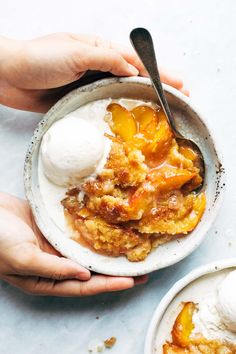 Amazing Peach Cobbler I have tried so many peach cobbler recipes and this is by far my favorite! best summer dessert ever! made with fresh peaches, sugar, and a topping that bakes like slightly underbaked cookie dough, with crunchy sugar broiled on top. Delicious Desserts, Yummy Food, Tasty, Easy Fruit Desserts, Best Peach Cobbler, Peach Cobbler Recipes, Peach Cobbler Crisp, Vegan Peach Cobbler, Peach Cobblers
