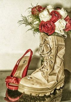 my wedding shoes, his boot, and my weddding bouquet With both of our boots... one with a jump boot and my boot, the other like this