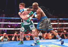 Did some experimenting with beams to show motion and provide more emphasis in still photos.  From Floyd Mayweather v. Canelo Alvarez.