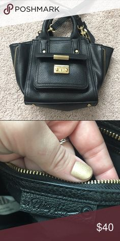3.1 Phillip Lim for Target Mini Pashli Satchel 3.1 Phillip Lim for Target Mini Pashli Satchel in black. Front pocket magnet came unglued from top latch and is stuck to its magnetic counterpart. Can be removed and reglued. See first picture for detail. Otherwise, in great condition. 3.1 Phillip Lim for Target Bags Mini Bags