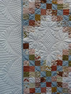Triple Irish Chain quilt - i like the loops thru the center of the chain. Wonder if I am brave enough to do feathers off them. or maybe just echo them.