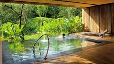 View pictures of exquisite indoor pool designs. An indoor swimming pool offers the luxury of year-round enjoyment as well as privacy. Amazing Swimming Pools, Indoor Swimming Pools, Cool Pools, Indoor Pools In Houses, Living Pool, Outdoor Living, Outdoor Spa, Indoor Outdoor Pools, Spas