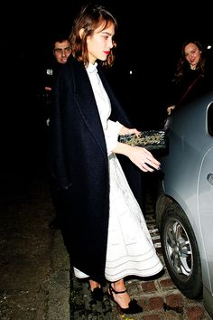 Alexa Chung wearing Edie Parker Bespoke Personalized the Flavia Clutch, Erdem Spring 2015 and Paul Andrew Smoking Pumps
