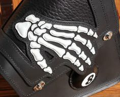 Custom swing-arm bag for Victory Vegas 8 Ball motorcycle. Close-up of the skeleton hand.