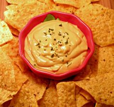 "Cashew ""nacho"" Cheese   1/2 cup raw cashews 1 teaspoon sea salt 1 cup water 1/2 cup nutritional yeast flakes 1 teaspoon Dijon mustard  Additional water A couple dashes of Tabasco sauce (optional)"
