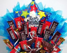A handmade arrangement of your favorite candy in a birthday box with a birthday balloon. Arrangement contains a mixture of candy including Kit Kat, Skittles, Tw Birthday Candy, Blue Birthday, Birthday Box, Birthday Balloons, Birthday Gifts, Happy Birthday, Birthday Ideas, Candy Arrangements, Birthday Bouquet