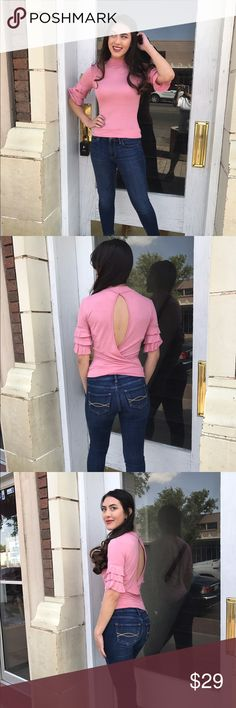 Pink Knit Top New Listing: 4/4/17-This adorable Top reminds me of a flamenco top with those adorable quarter ruffle sleeves. The open back gives it another flair. 95% Rayon 5% Spandex (This closet does not trade) Boutique Tops Tees - Short Sleeve