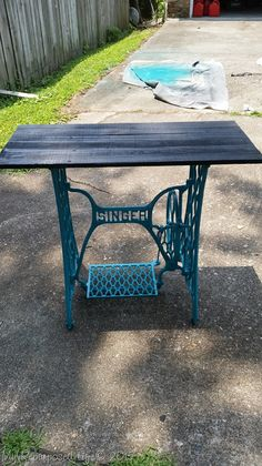 how to make an easy side table with a repurposed singer sewing machine and some reclaimed wood. Spray paint gives it an extra pop of color. Tire of it? change it up!
