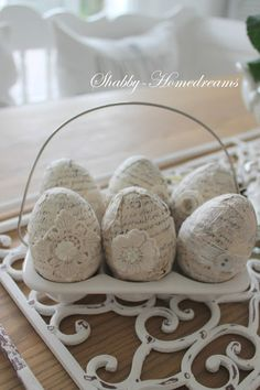 Shabby Homedreams....cute idea, find or make (out of egg carton from 5 dozen box) egg holder, decorate, put in wire and make decorative eggs....