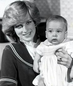 Princess Diana holding an infant Prince William