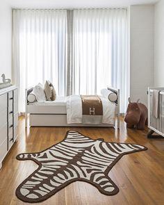 Neutral nursery with hardwood floors and fur rug | Sissy and Marley