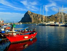 A red fishing boat in a port in San Vito Lo Capo     |   10 Top Rated Tourist Attractions In Sicily