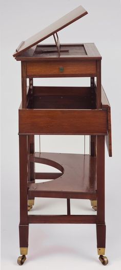 This rare George III mahogany retractable writing & architectural table has a mechanical pulley and adjustable bookrest and several other hidden functions that make it the perfect workspace for artists.