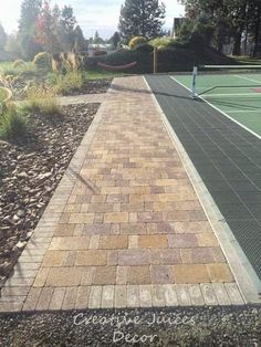 Creative Juices Decor: The PICKLEBALL Sports Court Completed! Backyard sports court using sport tiles.  Outdoor with landscaping ideas.  Pavers used as border.