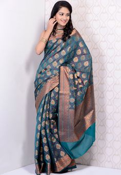 Magenta and teal green resham and zari woven chanderi Banarasi saree. Available with matching chanderi blouse, blouse shown in the image is just for photography purpose. (Slight color variation is possible. ) data-pin-do=