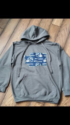 Mens Graphite Hoodie with Seahawks name and helmet by MaryEGuad, $45 mens sizes small - xxl