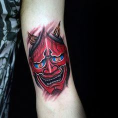 Red Ink Hannya Mask With Glowing Blue Eyes Mens Arm Tattoo