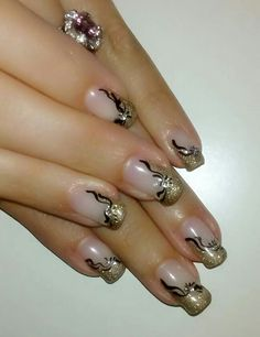 Gold glitter manicure with black design and rhinestones. Nails. Real nails.