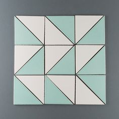 Try two contrasting colors of triangle tiles for a geometric look. This is Frost and Glacier Bay Fireclay Tile Fireplace Tile Surround, Fireplace Surrounds, Mosaic Tiles, Tiling, Backsplash Tile, School Murals, Fireclay Tile, Geometric Tiles, Best Flooring