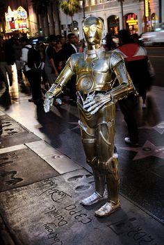 C-3PO in his footsteps at the Grauman's Chinese Theater in Hollywood, California