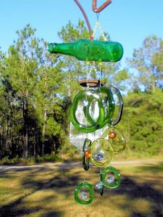wind chime crafts made of empty green glass bottles upcycling ideas for the backyard