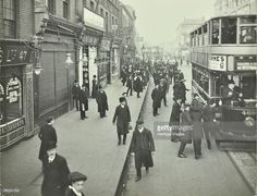 People rushing to get on a trolley bus at 7.05 am, Tooting Broadway, London, April 1912. Early-morning commuters catch a trolley bus to Charing Cross.