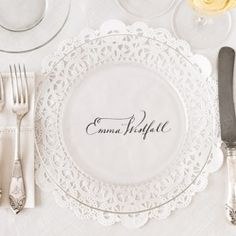 Clear plates with printed doilies underneath.