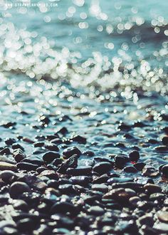 I wonder if I could recreate this in my future garden. I love the transition of water to pebbles.