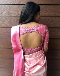 Top 30 Latest And Trendy Blouse Designs For Back Neck Here are the latest 30 blouse design for back neck that is impeccably immaculate and you can certainly opt for these or customize them as per your choice. Pattu Saree Blouse Designs, Wedding Saree Blouse Designs, Blouse Designs Silk, Designer Blouse Patterns, Latest Blouse Designs, Designer Saree Blouses, Pink Saree Blouse, Blouse Back Neck Designs, Simple Blouse Designs