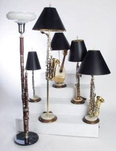 Turn old musical instruments into lamps...I'd choose different lamp shades!